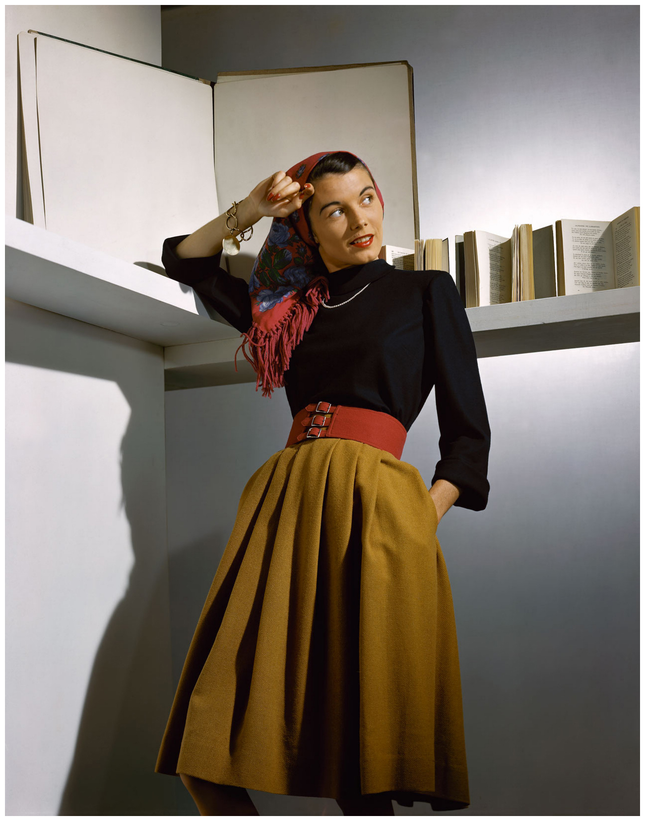 a-vogue-model-photographed-in-a-camel-coloured-wool-skirt-accessorised-with-a-wide-red-belt-a-fringed-scarf-and-pearls-1941-horst-p-horst-b