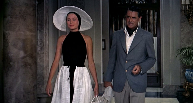 To-Catch-a-Thief_Grace-Kelly-Cary-Grant_Black-beach-wear_front-hat